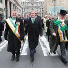 Taoiseach Enda Kenny (centre) takes part in the annual St Patrick's Day parade in Philadelphia, as part of his US visit (Niall Carson/PA)