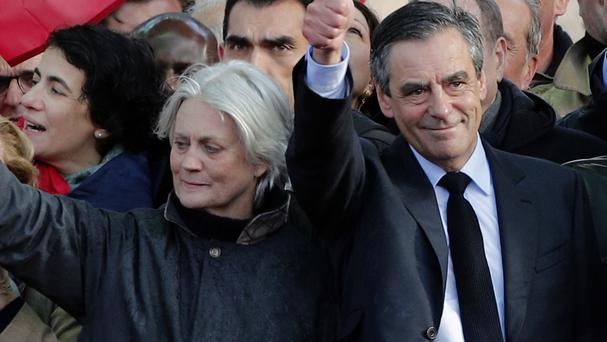 Francois Fillon with his wife Penelope (Christophe Ena/AP)