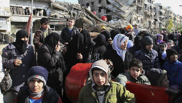 Hundreds of thousands of people live in besieged areas around Syria, mainly in areas surrounded by pro-government forces (AP)