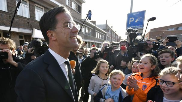 Dutch Prime Minister Mark Rutte is applauded after casting his vote (AP/Patrick Post)
