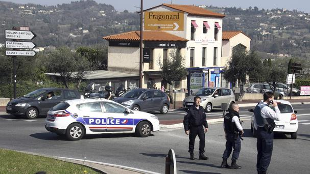 Police officers take position after an attack at a high school in Grasse, southern France (Philippe Farjon/AP)