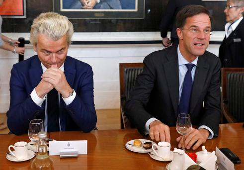 Dutch Prime Minister Mark Rutte, right, and far-right politician Geert Wilders take part in a meeting at the Dutch Parliament in The Hague, yesterday. Photo: Reuters/Yves Herman
