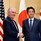 US Secretary of State Rex Tillerson, right, and Japanese Prime Minister Shinzo Abe shake hands before their meeting at Abe's official residence in Tokyo.