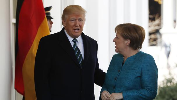 President Donald Trump greets German Chancellor Angela Merkel. (AP/Pablo Martinez Monsivais)