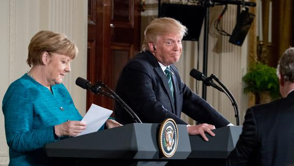 Angela Merkel and Donald Trump at a joint news conference in the White House (AP)