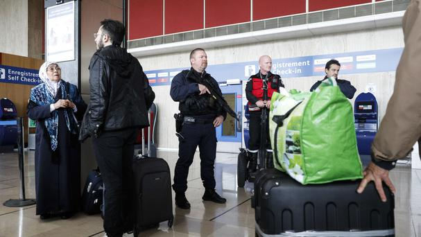A riot police officer patrols inside Orly airport, as flights resumed (Kamil Zihnioglu/AP)