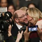 Martin Schulz, left, receives a kiss from party member Anke Rehlinger (Markus Schreiber/AP)