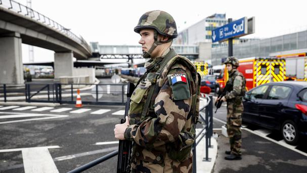 Soldiers patrol at Orly airport, south of Paris after a man who wrestled one of their colleagues to the ground and tried to steal her rifle was shot dead (AP Photo/Kamil Zihnioglu)