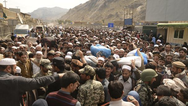 Afghan nationals at the border post with Pakistan at Torkham (AP)