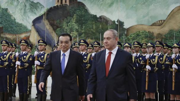 Chinese premier Li Keqiang and Israeli PM Benjamin Netanyahu during a welcome ceremony at the Great Hall of the People in Beijing (AP)