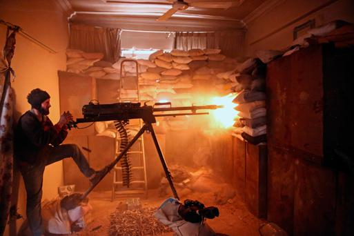 An opposition fighter from the Failaq al-Rahman brigade fires a machine gun in Jobar, a rebel-held district on the eastern outskirts of the Syrian capital Damascus. Photo: Amer Almohibany/AFP/Getty Images