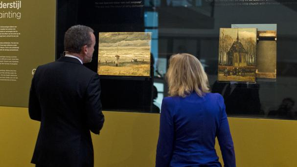 Van Gogh Museum director Axel Rueger and culture minister Jet Bussemaker admire the returned paintings (AP)
