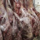 Employees work in a butcher's shop in Brasilia (AP)