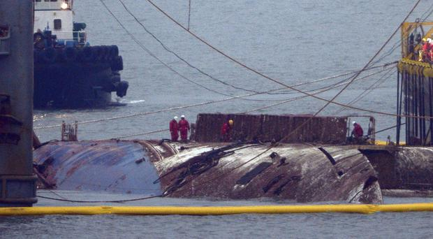 South Korean ferry in which 304 died lifted from the sea