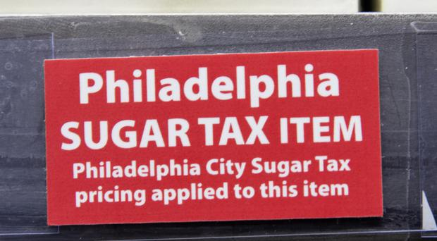 A sticker alerts customers of the sugar tax posted by sweetened beverages at the IGA supermarket in the Port Richmond area of Philadelphia (AP)