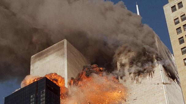 The horrific scene after the hijacked planes hit the World Trade Centre towers in New York (AP)