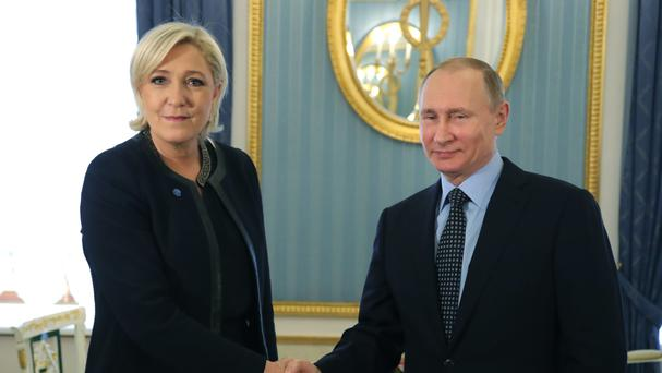 Marine Le Pen meets Vladimir Putin at the Kremlin in Moscow (Sputnik/Kremlin Pool Photo/AP)