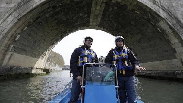 Italian police patrol the Tiber River in Rome before a European Union summit commemorating the 60th anniversary of the Treaty of Rome (AP)