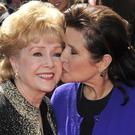 A public memorial service for Carrie Fisher, right, and her mother Debbie Reynolds will be held at Forest Lawn Cemetery (AP)