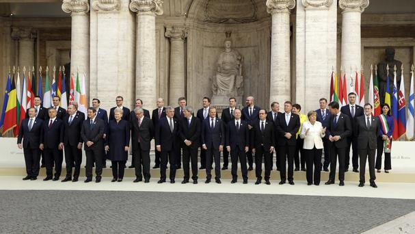 European Union heads of state pose for a group photo in the Cortile di Michelangelo during a summit in Rome marking the 60th anniversary of the bloc's founding treaty (AP)