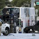 A SWAT team surrounds the bus along Las Vegas Boulevard (AP)