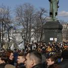 Protesters gather near the Alexander Pushkin monument in Moscow (AP)