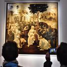 Visitors take pictures of Leonardo da Vinci's Adoration Of The Three Wise Men, returned to the public of the Uffizi museum in Florence, Italy (Maurizio Degl' Innocenti/ANSA via AP)