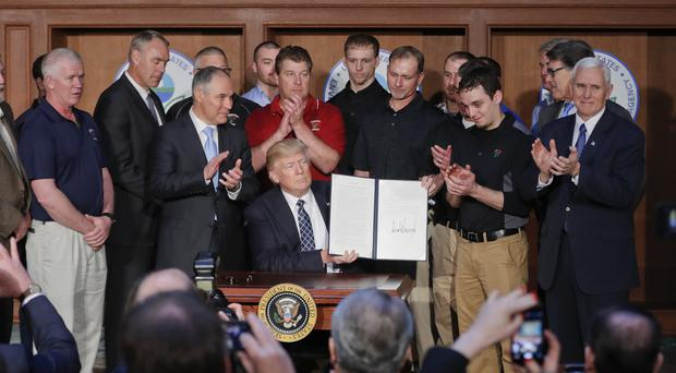 The president's order will lift a 14-month-old moratorium on new coal leases on federal lands (AP)