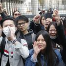 Demonstrators from the Asian community protest outside a Paris police station. (AP/Michel Euler)