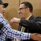 Marco Contreras, 41, right, is embraced by his father, Donacio Contreras, as he has his conviction overturned (AP Photo/Damian Dovarganes)