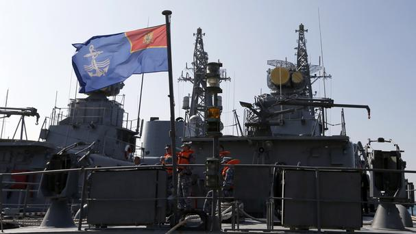 Montenegrin sailors stand on the light frigate Kotor in the harbour of Bar (AP)