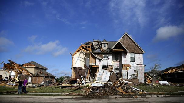 Houses are damaged following a storm in Rockwall, Texas (Rose Baca/The Dallas Morning News/AP)