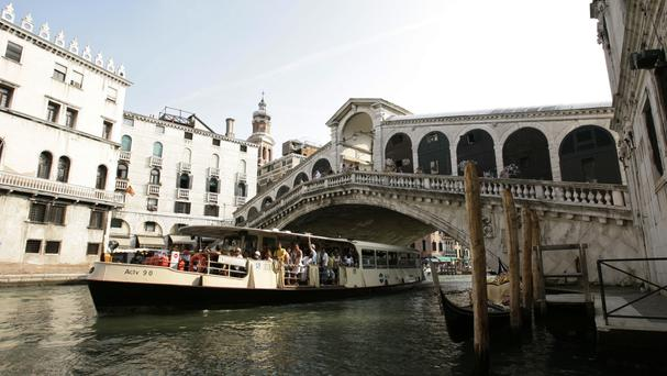 The Rialto Bridge in Venice is a big draw for tourists