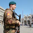 A soldier patrols Saint Mark's Square in Venice, Italy March 30, 2017. REUTERS/Manuel Silvestri