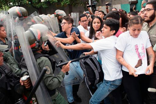 Protesters fight police at the Supreme Court in Caracas. Photo: AFP/Getty