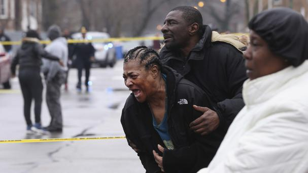 The grandmother of two young men who were shot dead in the South Shore neighbourhood of Chicago (Chicago Tribune/AP)