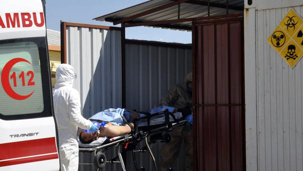 Turkish experts evacuate a victim of a suspected chemical weapons attack in Syria (DHA-Depo Photos via AP)