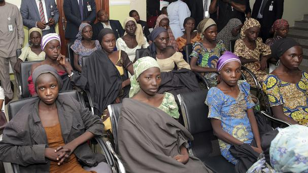Some of the Chibok schoolgirls freed from captivity (Sunday Aghaeze/Nigeria State House via AP)