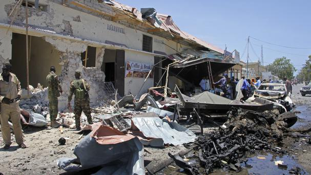 Somali security forces at the scene of a car bomb attack on a restaurant in Mogadishu (AP/Farah Abdi Warsameh)