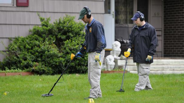 Agents search the garden at the home of reputed Connecticut mobster Robert Gentile in 2012 (AP)