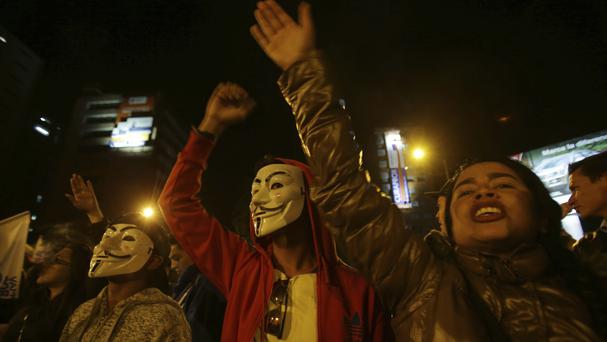Supporters of presidential candidate Guillermo Lasso protest in Quito (AP)