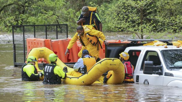 Severe storms have hit the south-east US (John Spink/Atlanta Journal-Constitution via AP)