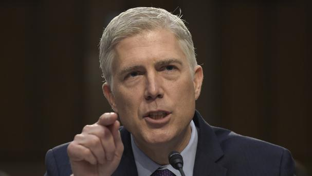 Democrats opposing Neil Gorsuch said they believe he would favour corporations over workers and would be on the far right of the court (AP/Susan Walsh)