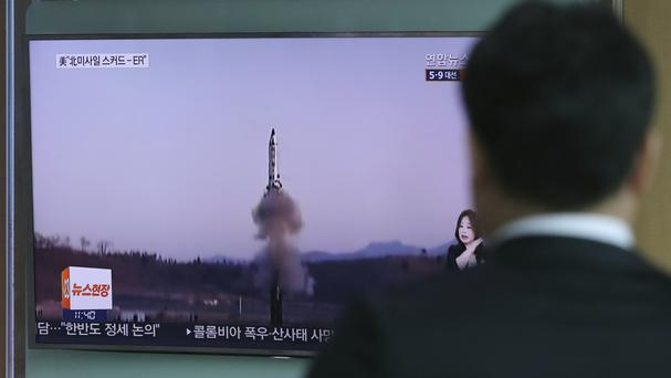 A man watches a TV report covering North Korea's missile testing, in Seoul, South Korea (AP)