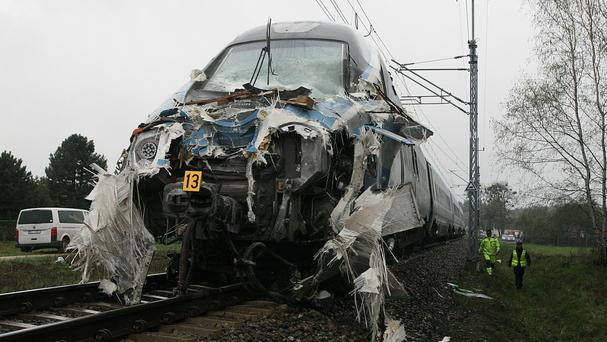 The damaged train that hit a truck at a railway crossing in Poland (AP)