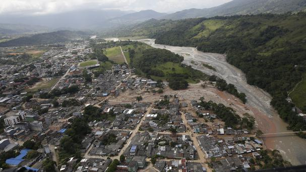 Destroyed and damaged homes seen from the air in Mocoa (AP)