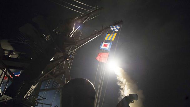 The USS Ross fires a Tomahawk missile during the strike on the Syrian air base (US Department of Defence/PA)