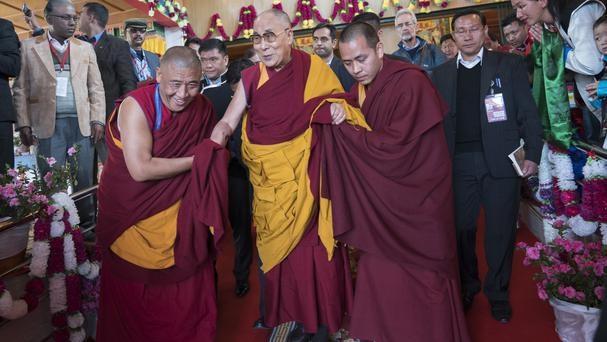 The Dalai Lama arrives to deliver teachings in Tawang, in the Indian state of Arunachal Pradesh (AP Photo/ Tenzin Choejor)