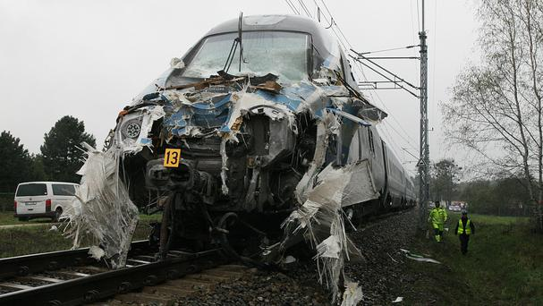 The damaged nose of a Pendolino fast train that hit a flat-bed truck at a railway crossing in Schodnia, Poland (AP)