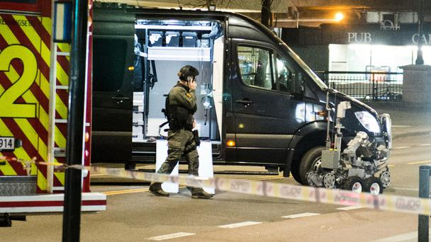 A bomb squad officer at the scene in Oslo (NTB scanpix/AP)
